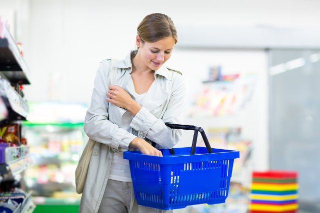 a lady grocery shopping with a basket
